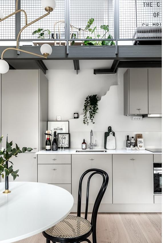 Ätico con estilo nórdico industrial cocina
