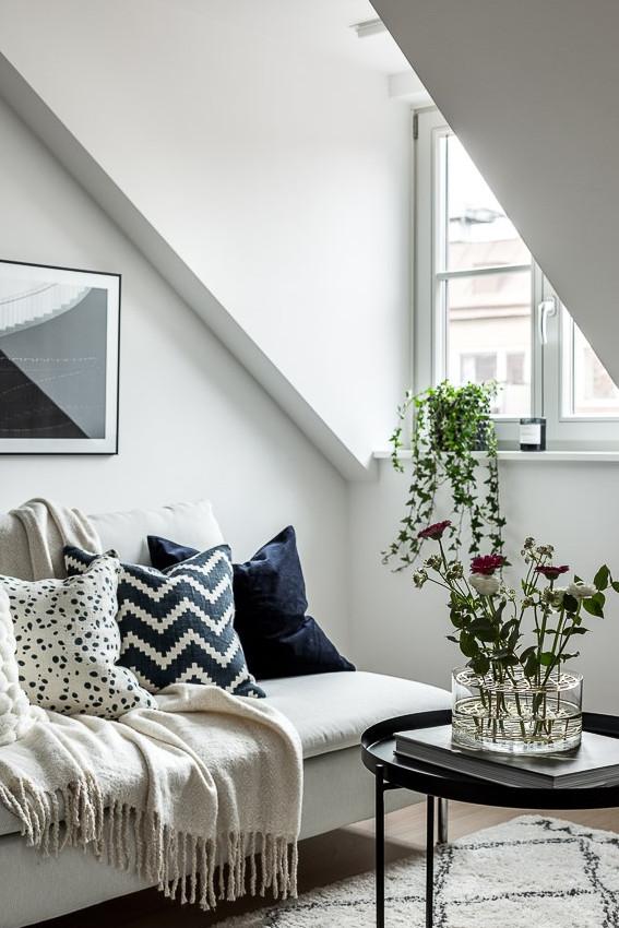 Ático con estilo nórdico industrial sofá