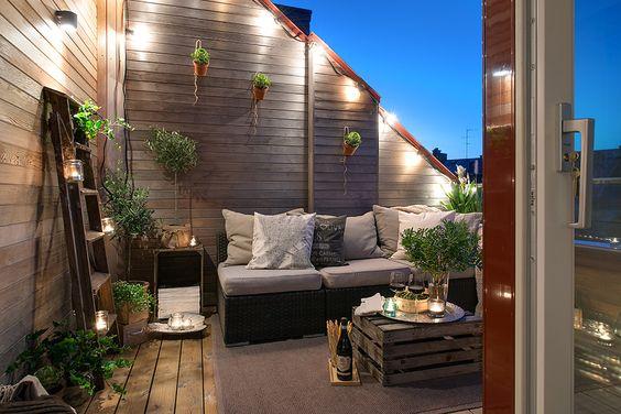 Decorar una terraza con estilo nórdico iluminación nocturna