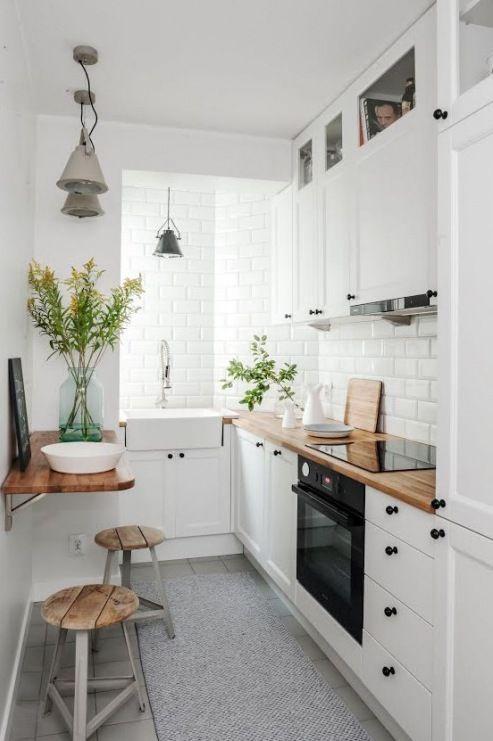 decoración nórdica con plantas en la cocina