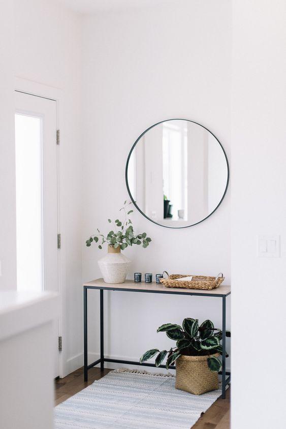 consola de estilo industrial con espejo redondo