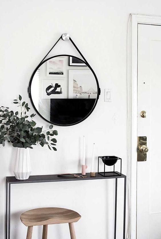 consola de estilo industrial con espejo tipo Adnet