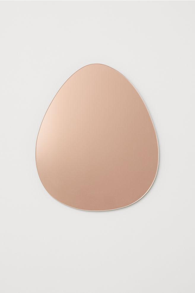 Y también este espejo rosado con forma de lágrima: